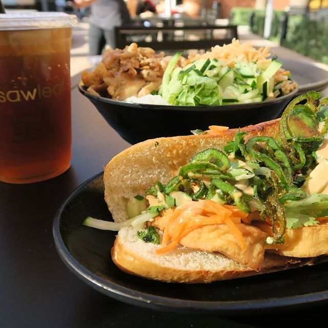 Sawleaf Vietnamese Cafe in Irvine, CA • Pick 2 Combo: Soy Garlic Tofu Banh Mi - Toasted artisanal baguette stuffed with choice of protein, pickled carrots, cilantro and house made sriracha aioli. Ask for fried jalapenos for a little heat 😄 • Lemongrass Chicken Bun. Noodle Salad topped with choice of protein, pickled carrots, shredded lettuce and sliced cucumbers. Toss with sweet chili dressing. The full version comes with eggrolls but you can get them a la carte too! • • #mealswithjamie #banhmi #sawleafcafe #vietnamesefood #bun #noodlesalad #forkyeah #foodiegram #eatfamous #yahoofood #spoonfeed #feedyoursoull #eatstagram #eattheworld #devourpower #foodiechats #feastagram #satisfeed #noleftovers #foodilysm #eatersanonymous #dailyfoodfeed #eater #infatuation