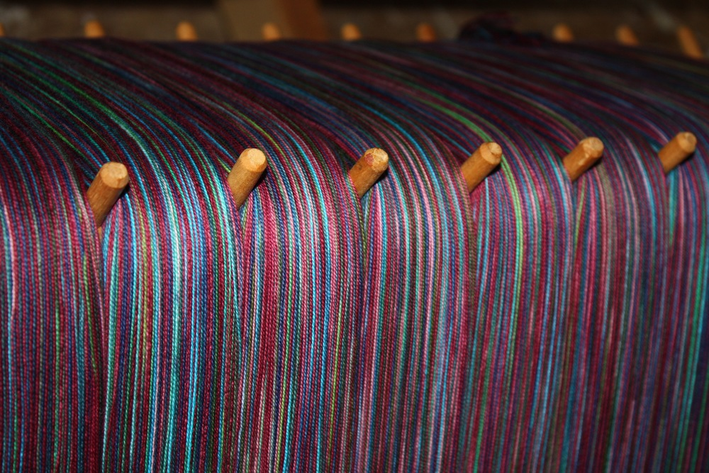 Handpainted warp for a baby wrap | 14 Mile Farm Handweaving and Homesteading in Alaska