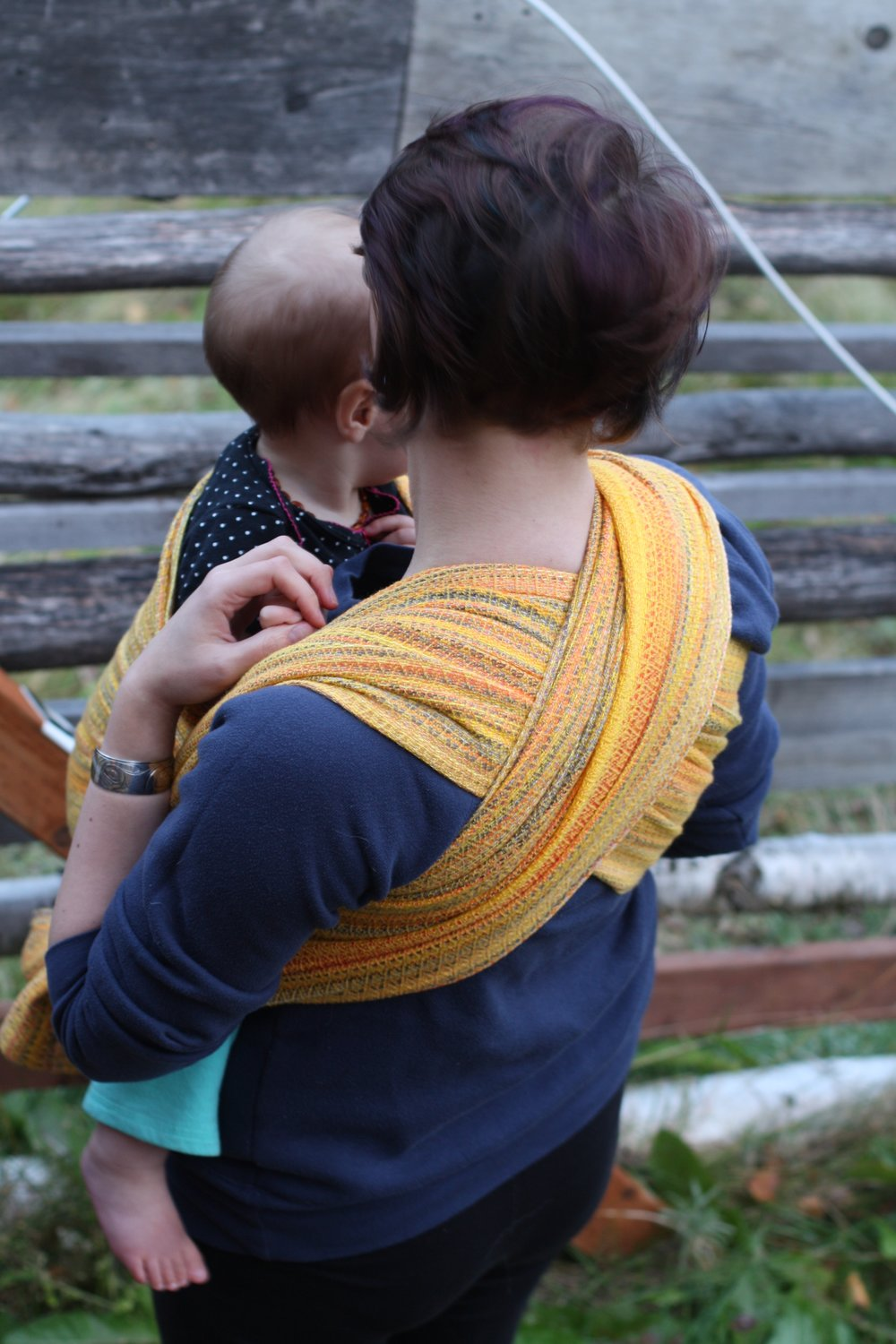Snowbirding, an autumnal sunset handwoven baby wrap with yellow wool weft | 14 Mile Farm Handweaving and Homesteading
