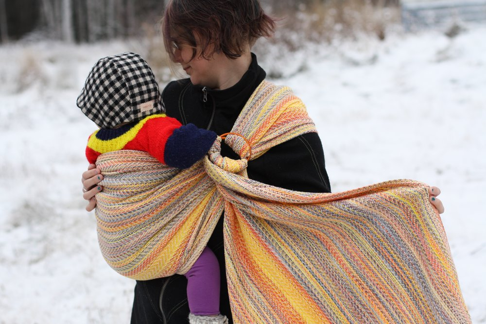Snowbirding, an autumnal sunset handwoven baby wrap ring sling with natural egyptian cotton weft | 14 Mile Farm Handweaving and Homesteading