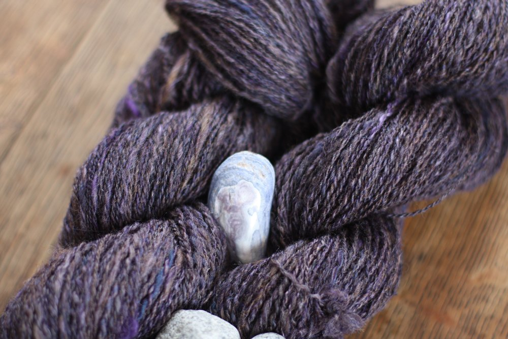 A beach combed mussel shell shows off textured handspun yarn | 14 Mile Farm Handweaving and Homesteading in Alaska
