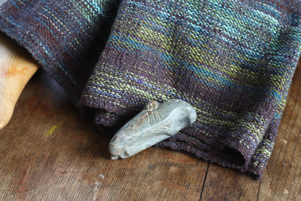 A soapstone carving meets handwoven fabric in a selkie inspired colorway | 14 Mile Farm Handweaving and Homesteading