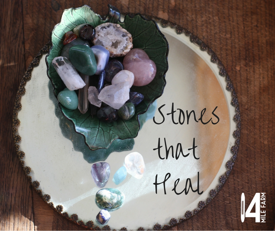 A bowl of crystals and stones rests on a moon charged mirror | 14 Mile Farm Handweaving and Homesteading
