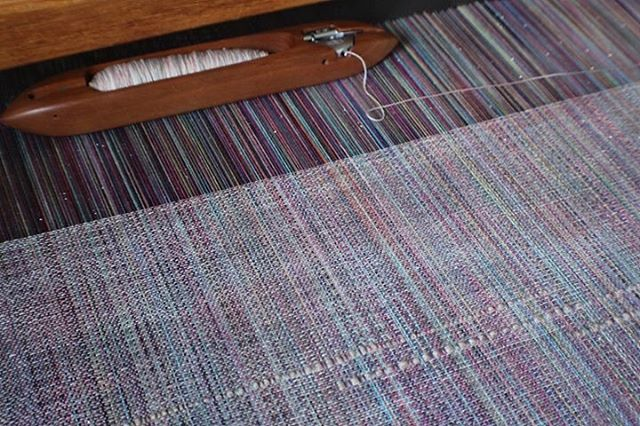 When a warp starts to come to life 😍 🌈Prismatic Healing by @stormborne_fiber_witchery is a sparkle Supima warp, and this first piece features a long staple Cottohemp weft. It's one of our favorite combinations. #prismatichealing #wovenwithloveandmagic #cauldronandcloth @cauldronandcloth #handwovenbabywrap #handwovenwrap #babywearingwrap #loomtowrap #l2w @loomtowrap #babywearing #closeenoughtokiss #attachmentparenting  #carrythem #babywearingweaver #visibleandkissable #babywearersofinstagram #saltwaterrosethreads @saltwaterrosethreads