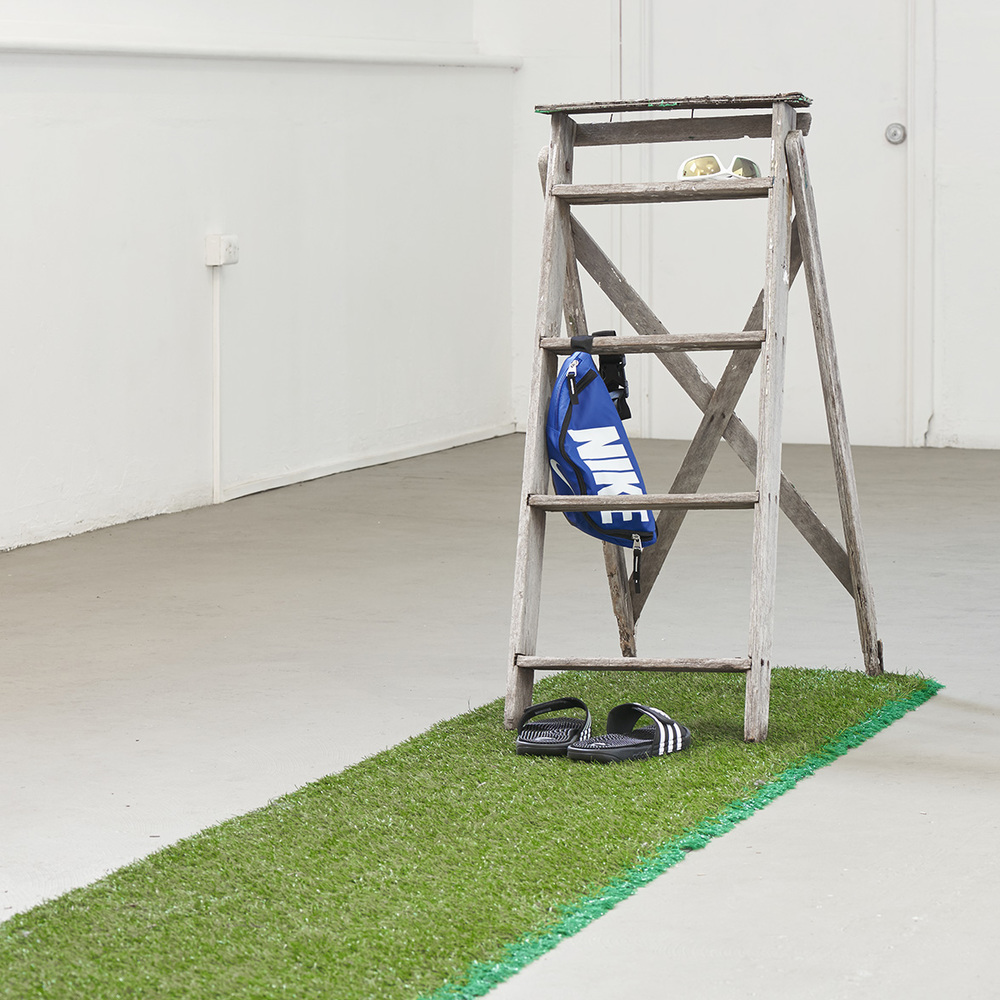 Eshay  2015 Found ladder, Astroturf, Nike bumbag, Adidas slides, found sunglasses  Photo: Henry Whitehead Imaging