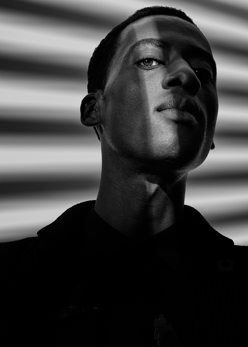 Study of light and shadow with model, stylist and actor Abss Dumont. Personal work by Dragos Ionescu.
