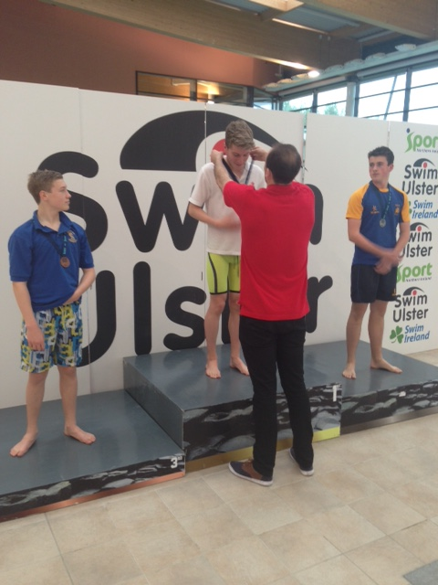 Luke Balfour receiving his gold medal for the Intermediate 100m Breaststroke..JPG