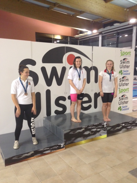 Emma Reid (middle) came 1st in the Senior 100m Butterfly and the Senior 100m Freestyle..JPG