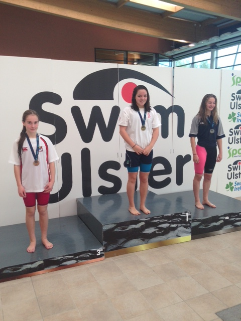 Rebecca Reid with her gold medal for the Junior 100m Butterfly.JPG