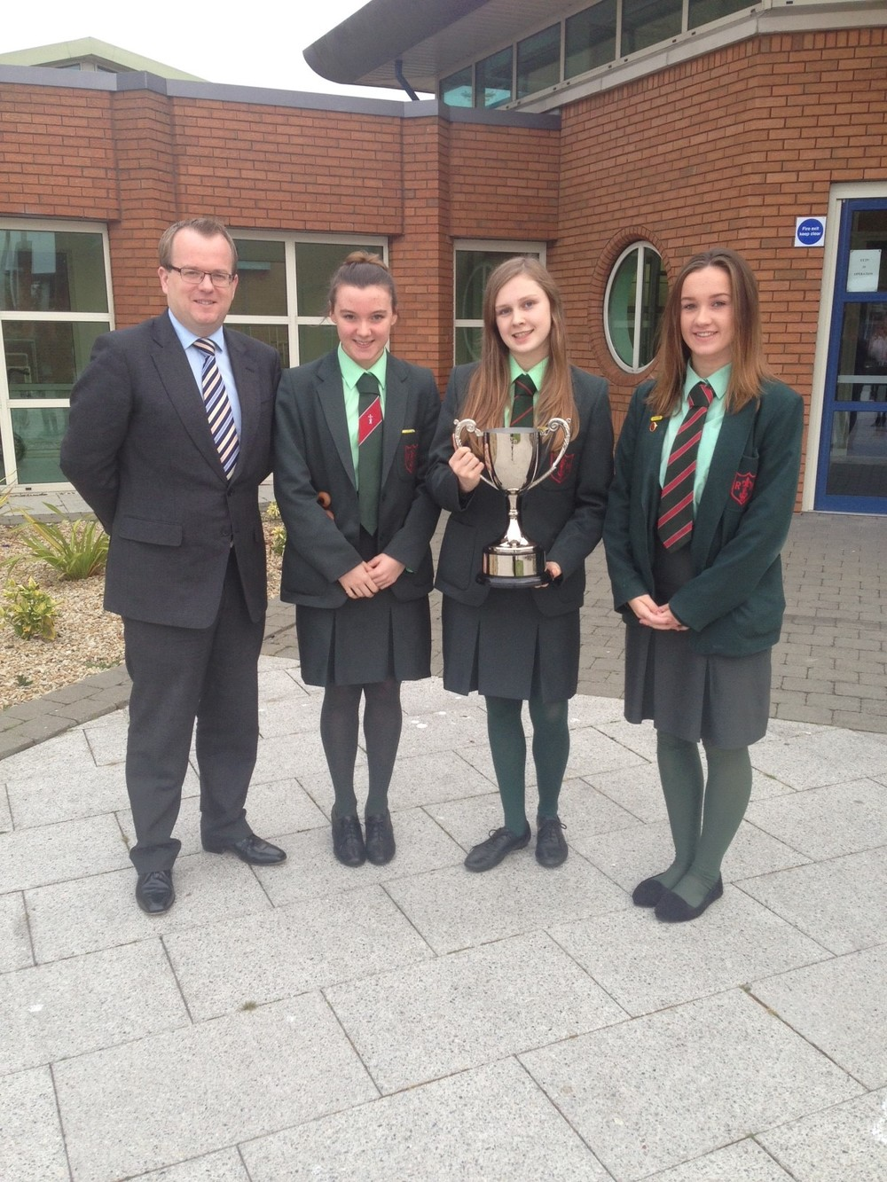 Mr Carville with the senior girls and the Nocher Cup.JPG