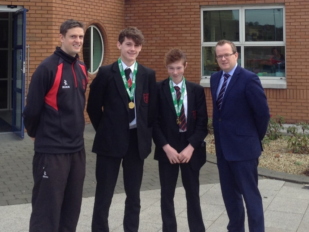 Coach Mr D Robb, with Frazer, Sam, and Mr M Carville, Headmaster