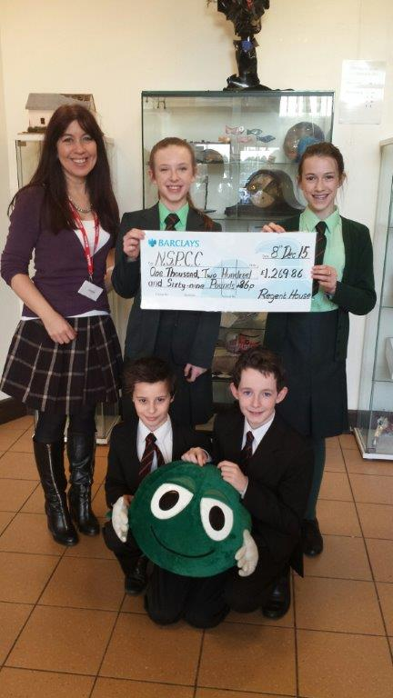 Lisa Rodgers from the NSPCC with Rachel Conkey, Chloe Nesbitt, Andrew Brown and David Anderson from 8A