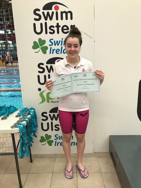 Naeve Pountney with her certificates for reaching the finals of the Junior Girls Backstroke and Freestyle events.jpg