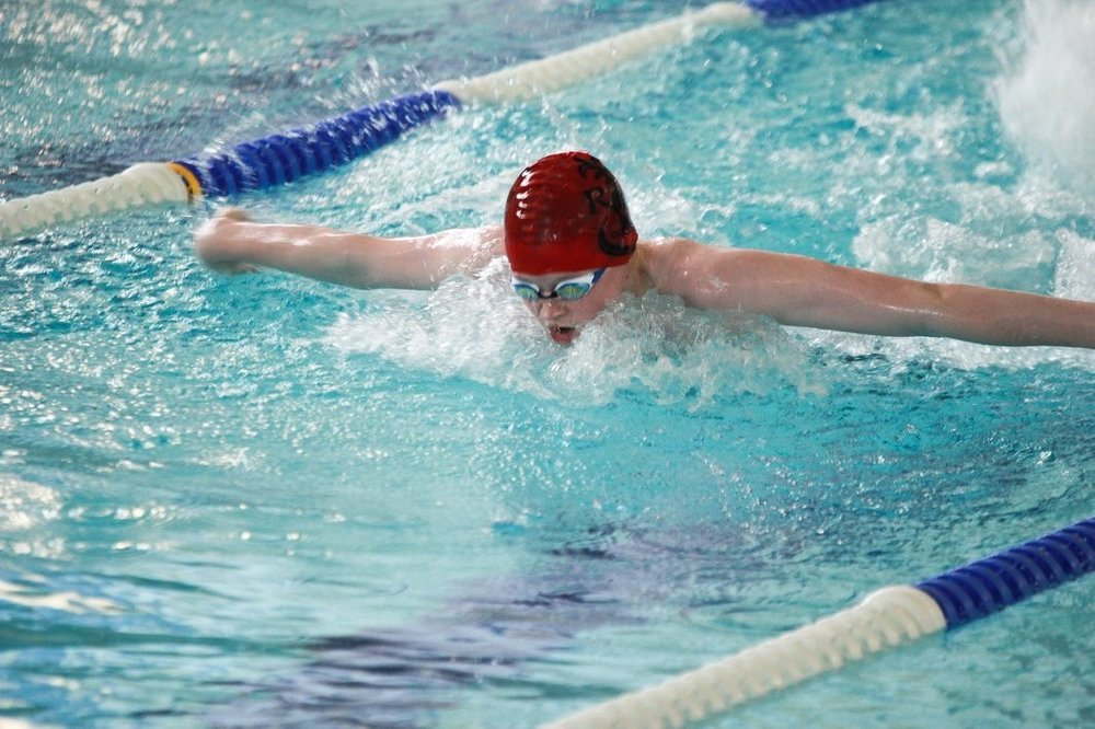 Adam Barnes competing in the Junior 100m Butterfly.jpg