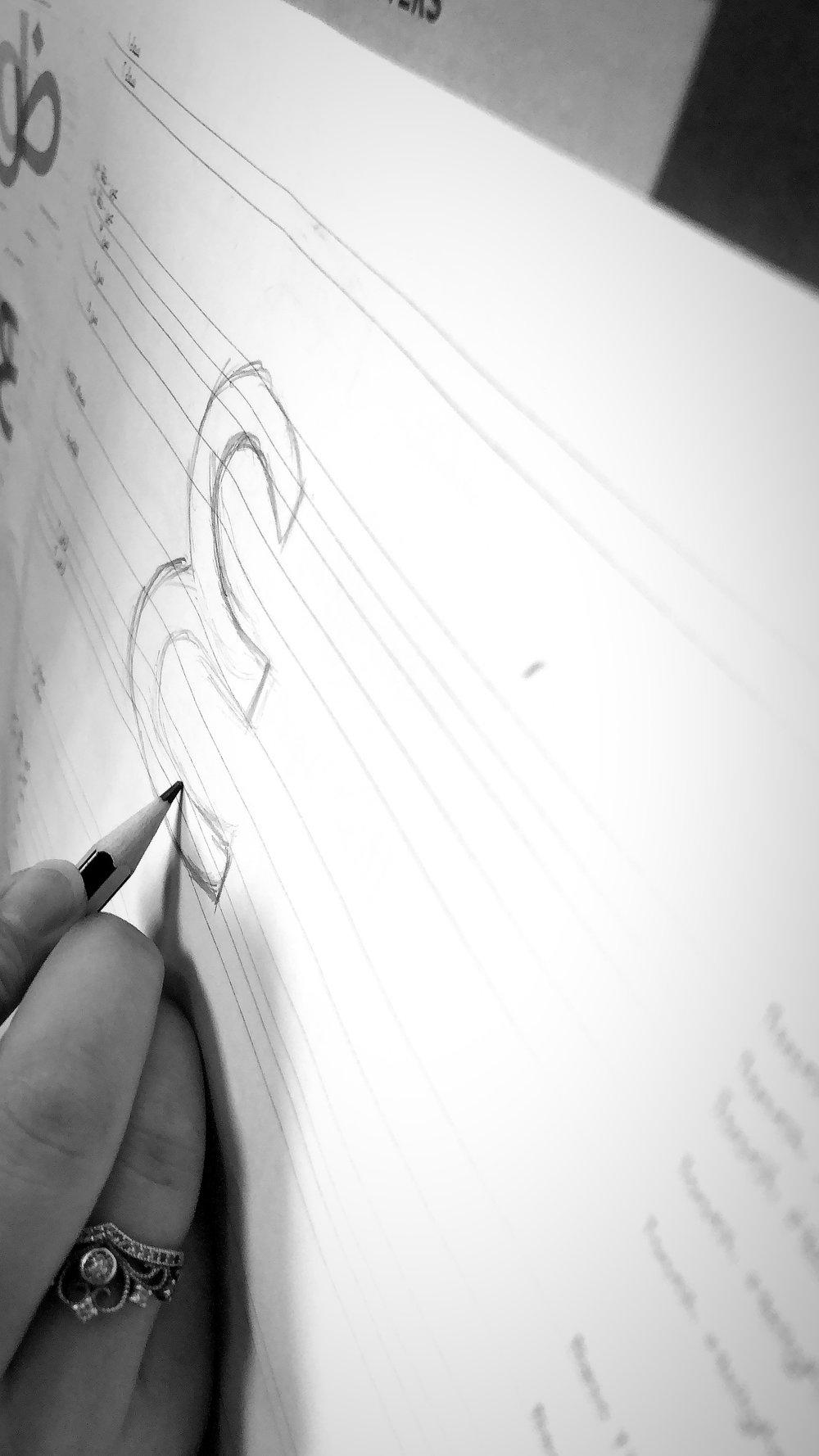 Participant constructing Arabic letter 'Ain'.