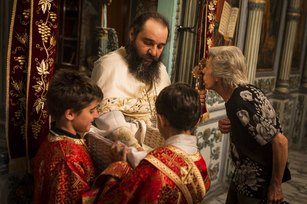 A Christian worshipper receive the Holy Communion in the Mar Elias Monastery, a Greek Orthodox monastery in South East Jerusalem.