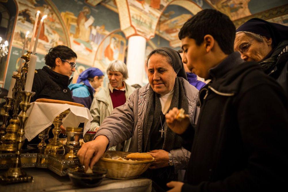 Christian worshipper take part of receiving the Holy Communion in the Melkite Greek Catholic Church.
