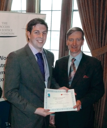 Ryan Whelan receiving his award from the Attorney General Dominic Grieve QC