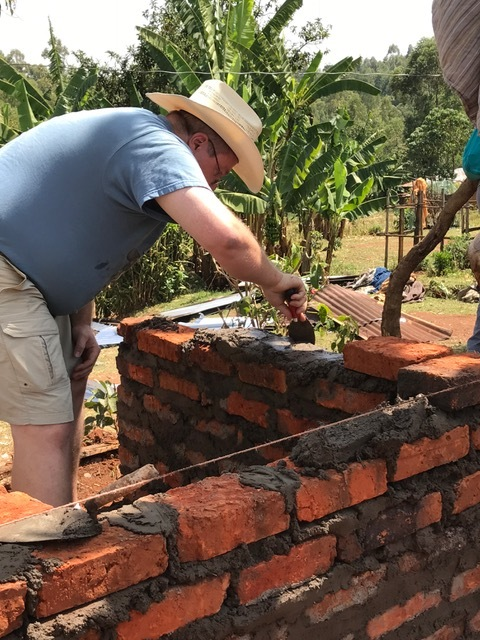 Dave helping with our Kenyan friends to build a brick outhouse