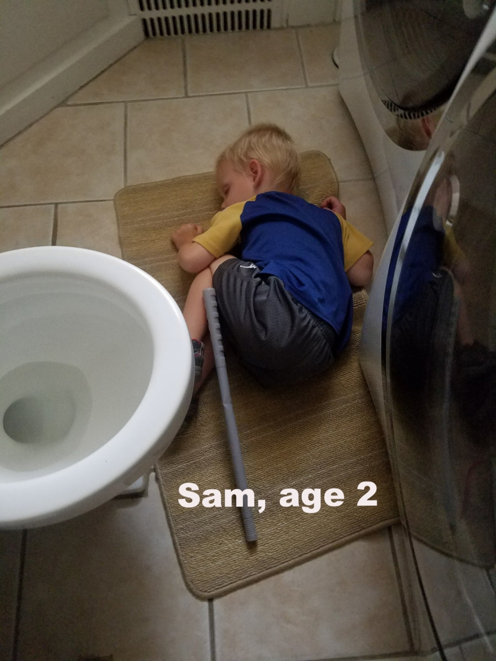 Here lies Sam, worn out after a potty training battle. See? Wouldn't it have been better for the poor little guy if this had been a springier, softer surface instead of this cold, tile floor? YES!