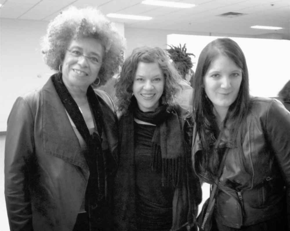 "With human rights activist and feminist theorist Angela Davis and HADVC PhD student Alexandra Duncan during Angela's visit to the University of Alberta to speak "" On Prisons, Race, and Gender Based Violence "" - March 2014"