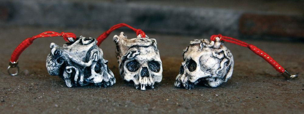 """Untitled (skull & octopus netsuke).  2011 - urethane plastic. 1"""" x 1"""" x 1""""."""