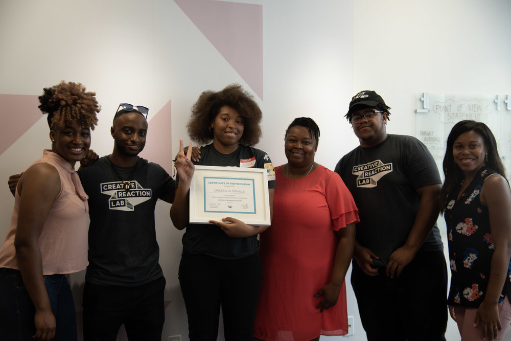 CrisTasha D., 2018 Design to Better [Our Community] Summery Academy, graduating with Creative Reaction Lab staff.