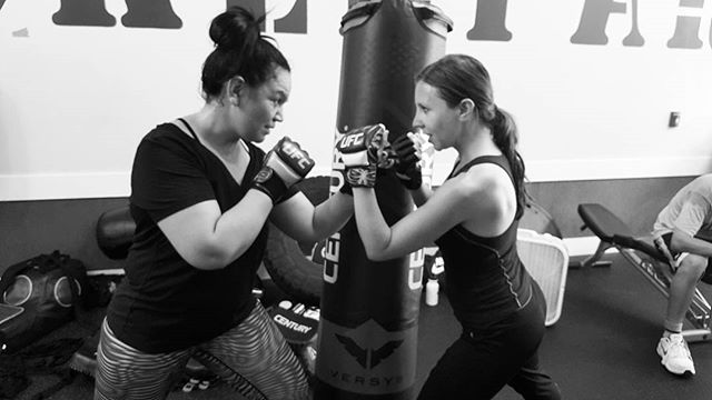 Lilia and Gancho facing off #ultimatefighter style. @lovely_ela_ Great Memorial Day Class. #boxfitfight #boxingbootcamp #wickerparkfit #bucktownfit #chitownfit @ufc @centurymartialarts @titleboxing @kali_active