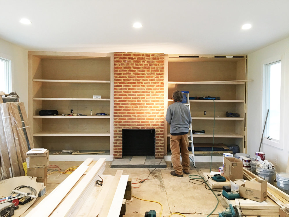 INSTALLATION OF CUSTOM ADJUSTABLE SHELVES.