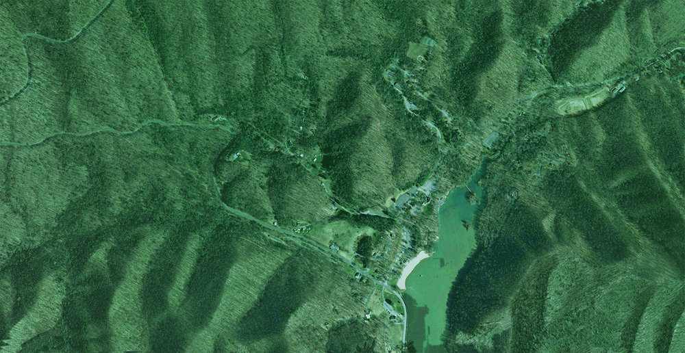 AERIAL OF HOUSE SITE VICINITY; THE PROPERTY IS ADJACENT TO HUNGRY MOTHER STATE PARK.