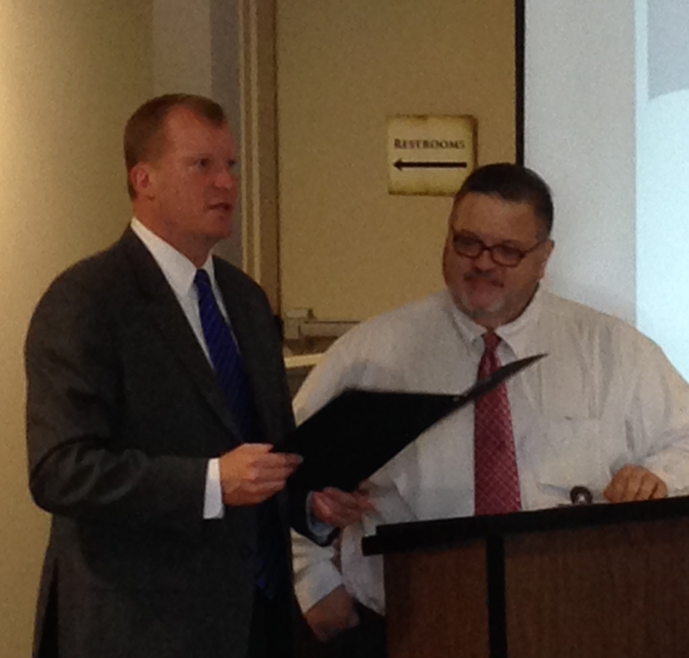 Dauphin County Commissioner and GA Advisory Board Member Mike Pries presents GA Founder & President Mike Macchioni with proclamation declaring April 25 Gemma's Angels Day in Dauphin County.