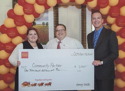 Wells Fargo representatives present a check to Gemma's Angels.