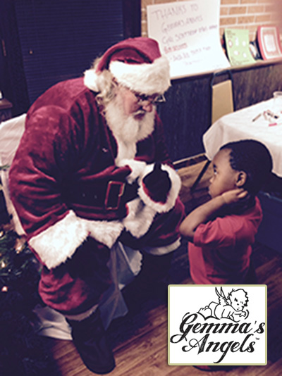 This little guy at Interfaith Shelter had a LOT to tell Santa!