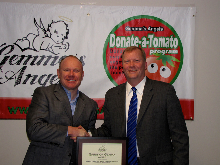 Chad Libby, Director of Dauphin County Office of Adult Probation and Parole, receiving the Spirit of Gemma Award from Gemma's Angels Advisory Board Member & Dauphin County Commissioner Mike Pries as the 2016 awards ceremony.