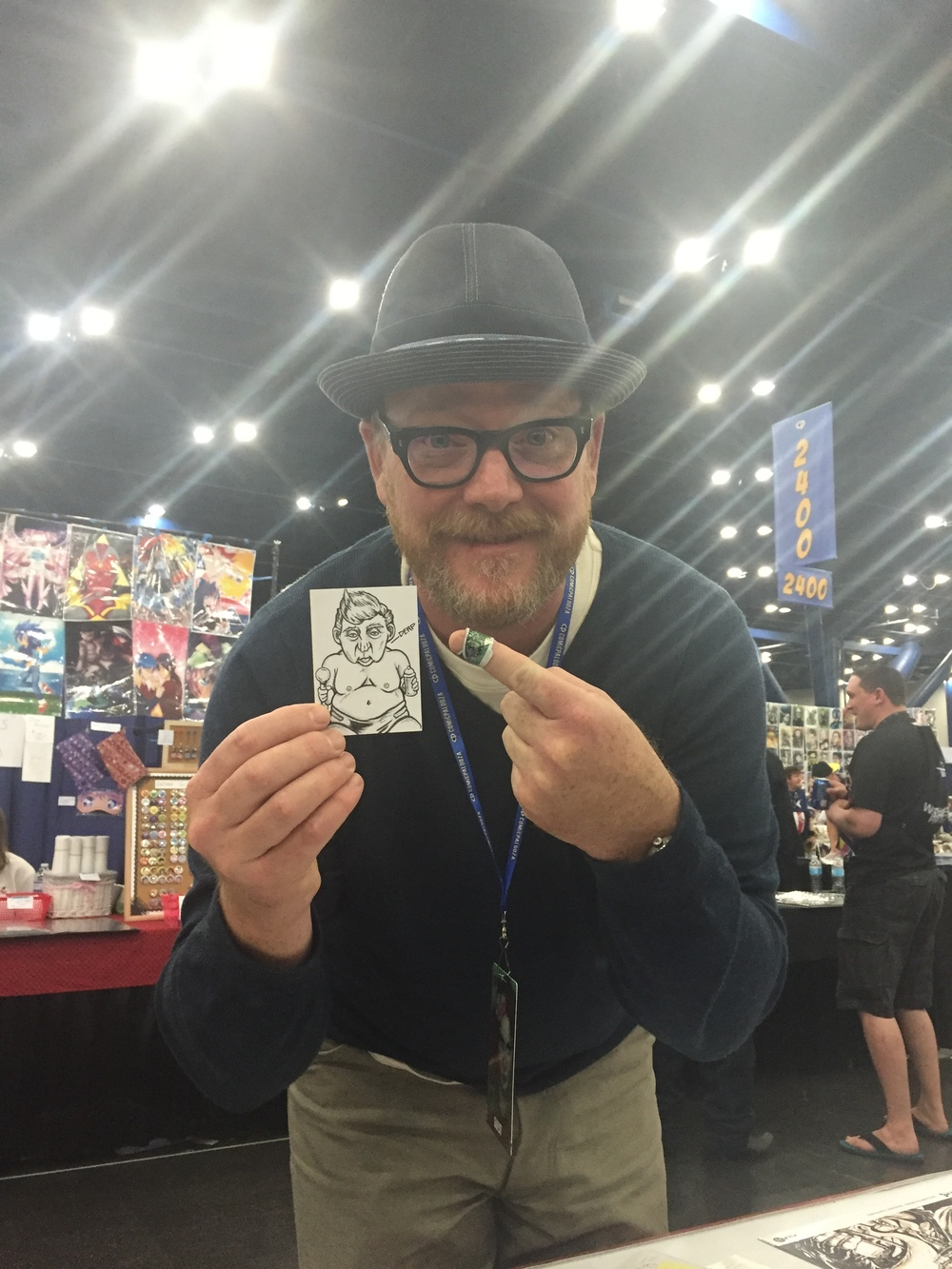 "Actor Robert Duncan McNeill, of Star Trek: Voyager, stopped by our table late Sunday afternoon, bought a few comics off of us, and became the proud owner of Aleisha Bayron's ""Baby Trump"" sketch card for his contribution to the cause."