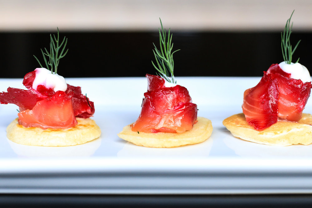 Beet and Vodka Cured Salmon served on blinis