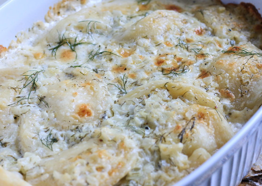 Homemade Perogies Baked in a Creamy Dill Sauce
