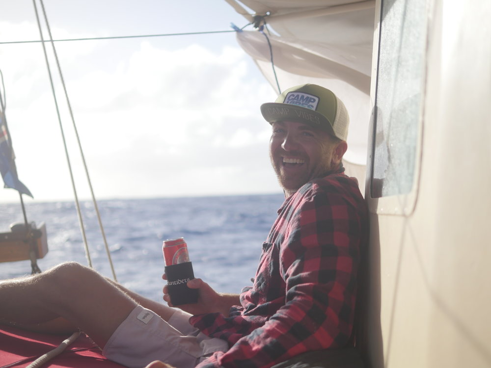 With the swell on the decline, Mike's looking pretty happy with a beer on the foredeck.