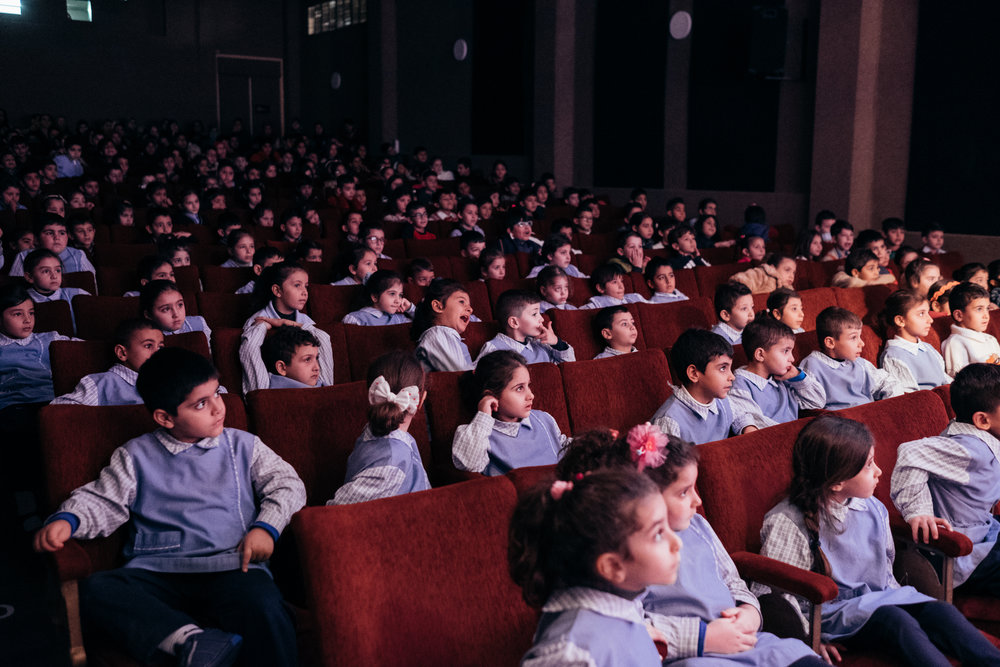 School kids in Beirut watching a theater play in Gemmayze.