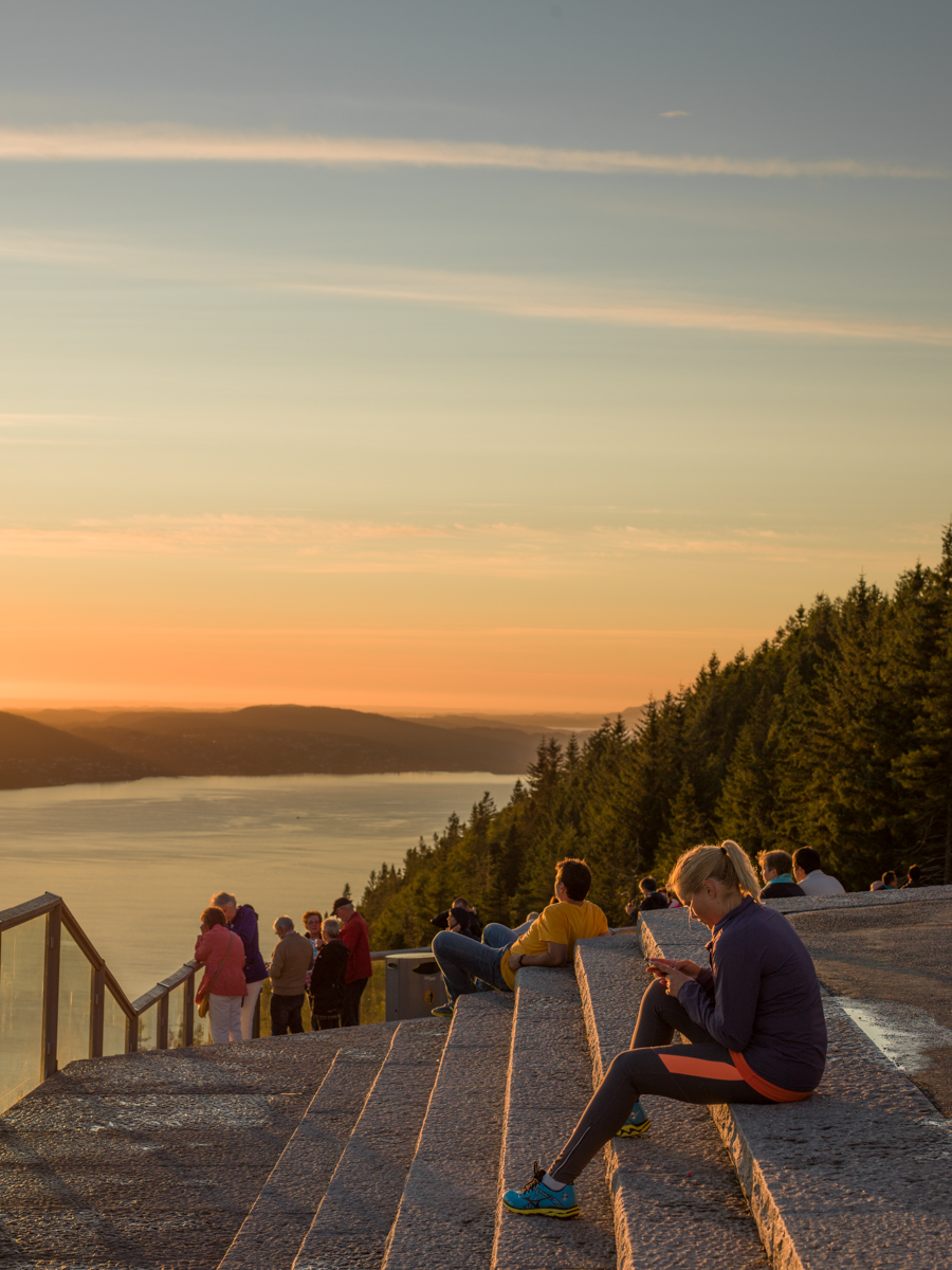 Tourists and Jogger enjoying the sunset at Mt Floyen Viewing Point