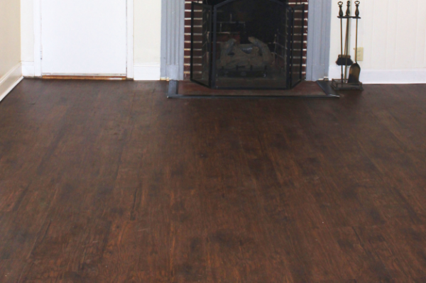 ... curved with the natural imperfections in our concrete slab, and I love  the rich color and grain details that make it really look like real wood. - Before & After: Faux Wood Floors - Blue Door Living