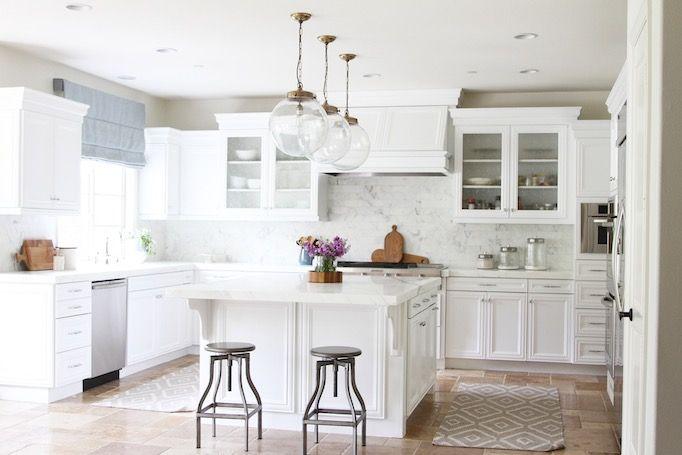 Kitchen makeover a cozy classic white kitchen blue door for Classic white kitchen designs