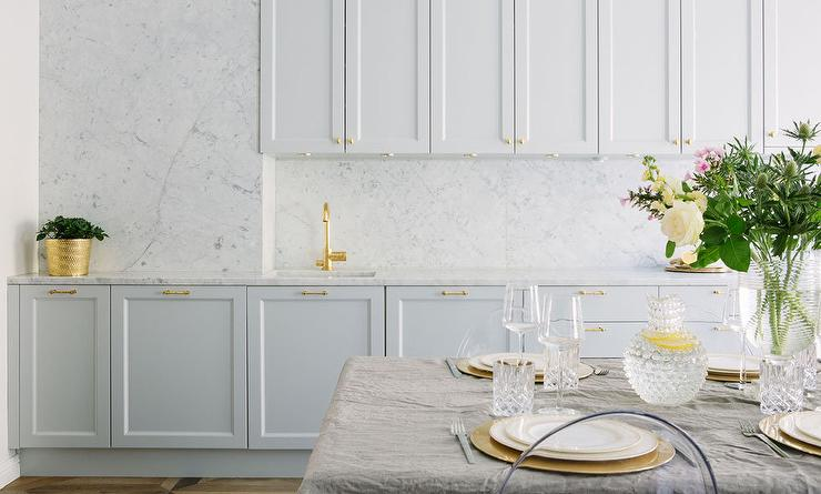 pairing brass cabinet hardware lighting fixtures and a brass faucet complete the tasteful and elegant look scroll down for a round up of my favorite brass