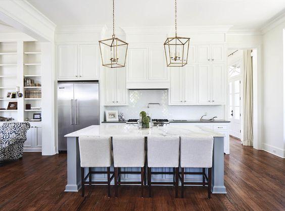 lanterns in white open floor plan kitchen