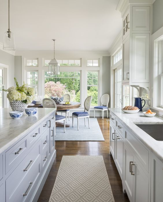 traditional blue and white kitchen open into dining room