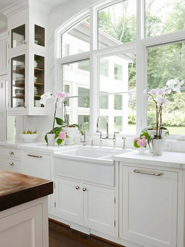 white kitchen with marble backsplash to ceiling