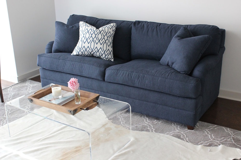 a blue sofa pop of color or glamorous statement piece blue door rh bluedoorlivingblog com navy blue sofas and chairs navy blue couch living room