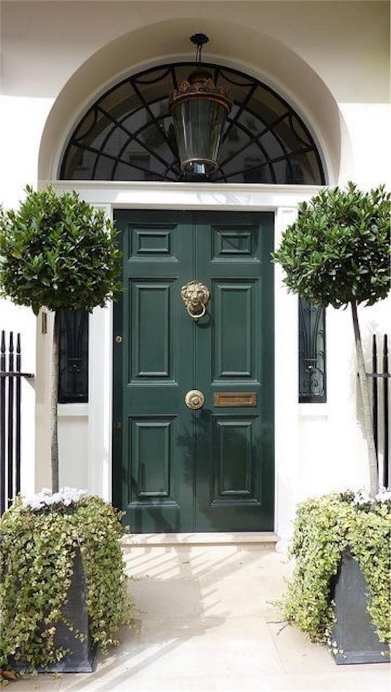 green-front-door-lion.jpg