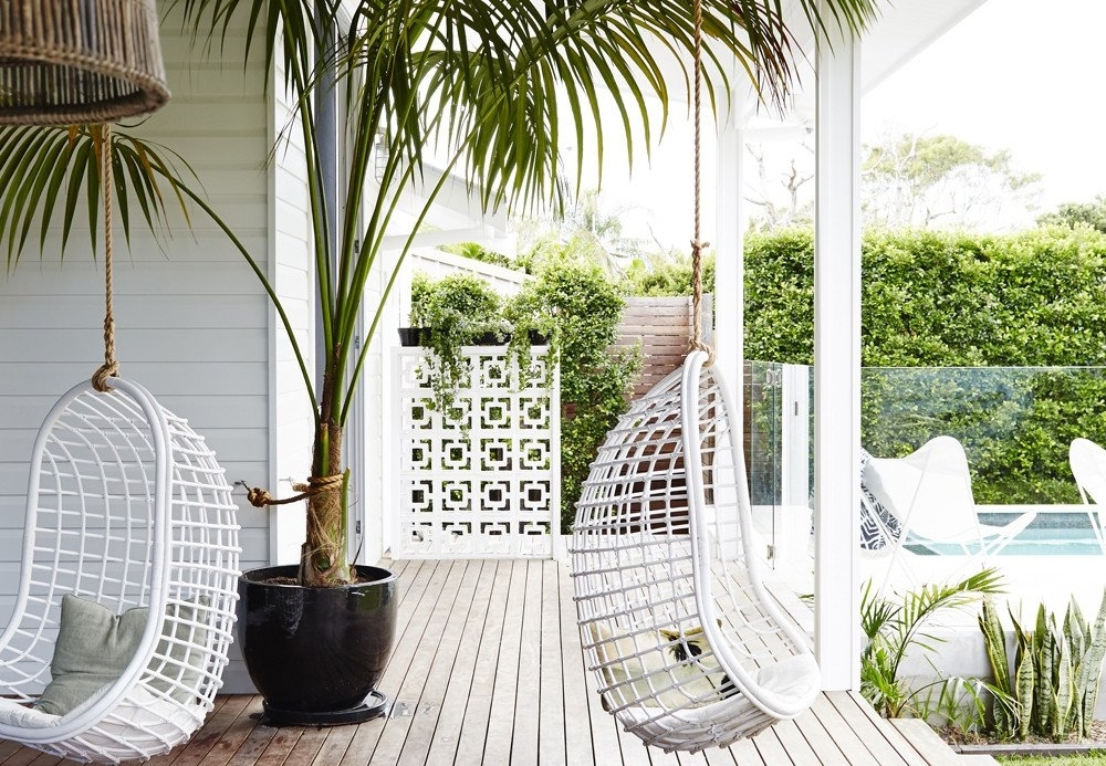 Make It Coastal - Mix in rattan in natural or white with blue and greens. Add palm leaves and potted palms for an extra effect.