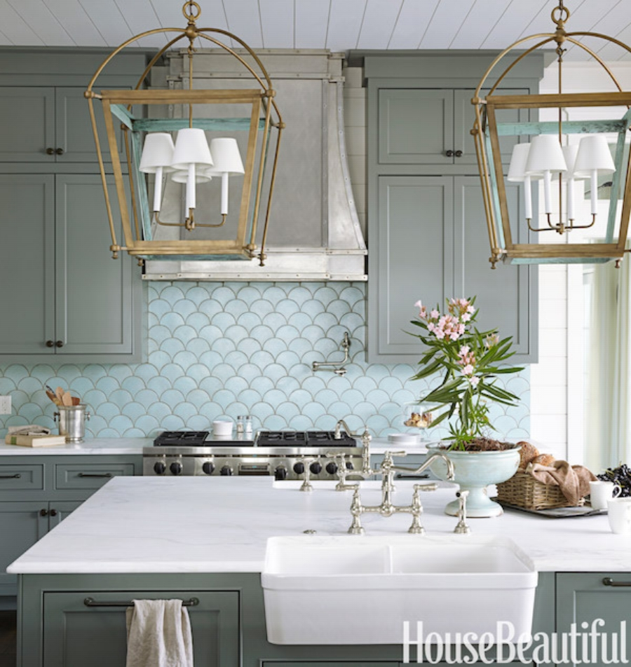 Bright blue fish scale backsplash makes this a unique but traditional kitchen